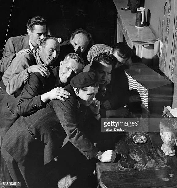 Hungarian refugees listen to a wireless in their lodgings at Donington Hall. Major Gillies Shield offered his Castle Donington home as a hostel for...