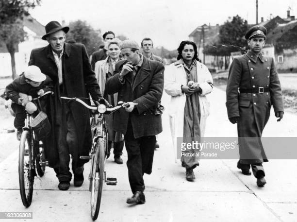 Hungarian refugees walking toward the border to Nickelsdorf, Austria, which is their point of freedom from the tyranny of the Soviet Masters of...