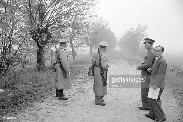 Hungarian Revolution: Gendarmes awaiting refugees at the Hungarian border. Austria. Photography. 1956. [Ungarische Revolution: Gendarmen warten an...