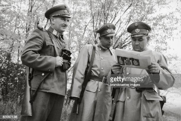 Hungarian Revolution Gendarmes awaiting refugees at the Hungarian border Austria Photograph 1956 [Ungarische Revolution Gendarmen warten an der...