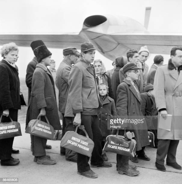 Hungarian Revolution: Hungarian refugees bording the plane for America at Schwechat Airport. Austria. Photography. 1956. [Ungarische Revolution:...