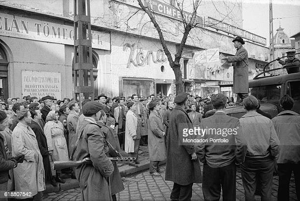 Hungarian revolution in 1956 A man standing on top of a van speaks to the crowd of insurgents during the uprising of the Hungarian people against the...