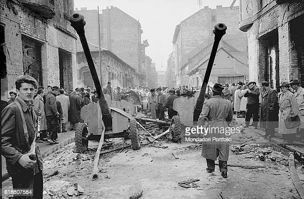 Hungarian revolution in 1956 Rebels and mortars on the street during the riots Budapest October 29 1956