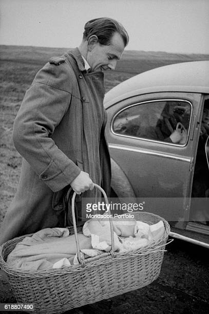 Hungarian revolution of 1956. A family of Hungarian refugees crossing the border between Austria and Hungary with a baby. November 1956