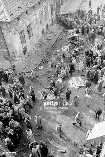 Hungarian revolution of 1956 The crowd looking at the ruins after the uprising that took place in the streets of the city Budapest 29th October 1956