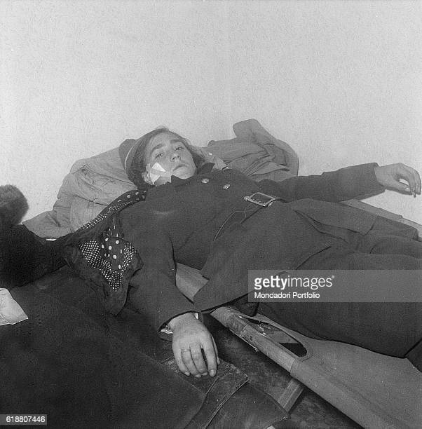Hungarian revolution of 1956 The young revolutionary Julia Sponga now a refugee in Austria with some other rebels having rest on a cot Eisenstadt...