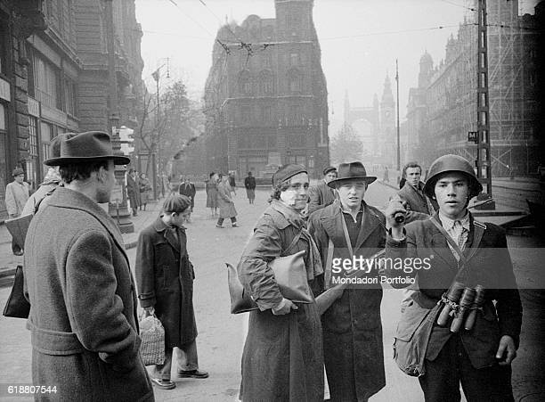 Hungarian revolution of 1956 Two young revolutionaries in the streets of the city during the uprising against the Soviet regime Julia Sponga and her...
