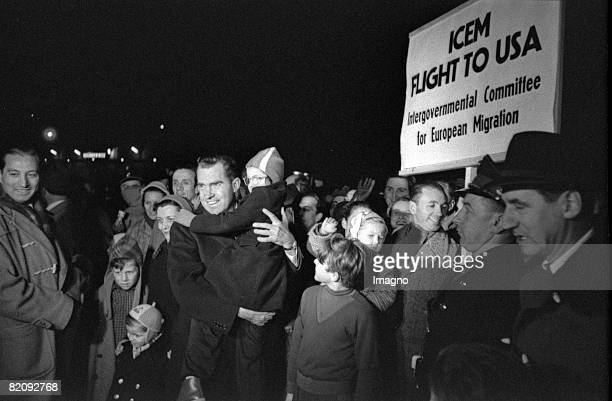Hungarian Revolution Richard Nixon the director of the american refugee aid with refugees at the airport Vienna 1956 [Ungarische Revolution Richard...