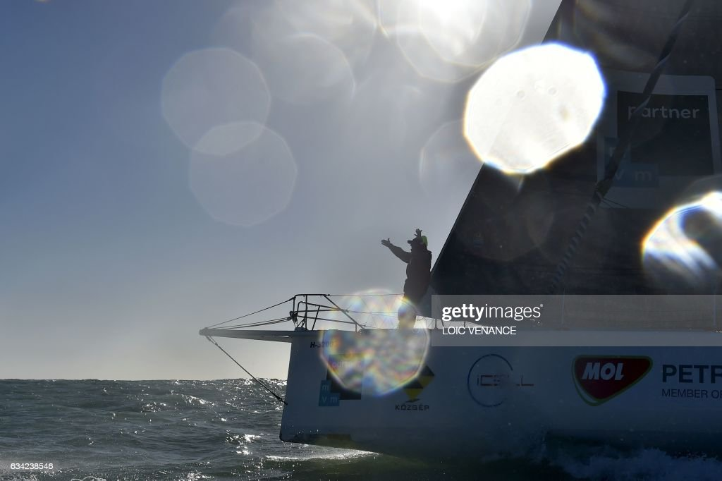 TOPSHOT - Hungarian skipper Nandor Fa celebrates as he arrives in Les Sables-d'Olonne to place 8th in the Vendee Globe solo around-the-world sailing race, western France, on February 8, 2017. /