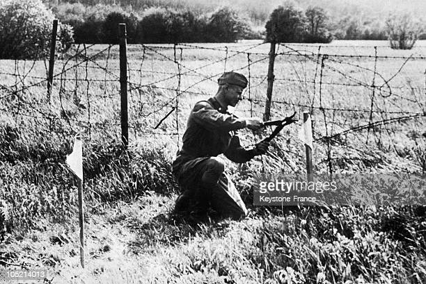 Hungarian Soldier Cutting The Barbed Wire Which Formed An 'Iron Curtain' Between Hungary A Communist Country And Neutral Austria On May 14 After...