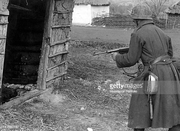 Hungarian soldier on the threshold of a house during a mopping up operation against bands of partisans in the Cherkasy area Ukraine September 1941