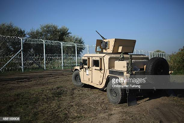 Hungarian soldiers begin to muster at the border with Serbia ahead of new laws for migrant entry to Hungary on September 14 2015 in Roszke Hungary A...