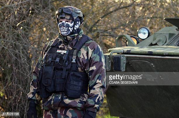 Hungarian soldiers control the metal fencesaved border line at Asotthalom border station of the HungarianSerbian border on February 24 2016 Hungary...