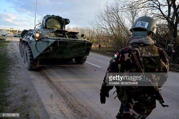 Hungarian soldiers control with their armoured car the metal fencesaved border line at Asotthalom border station of the HungarianSerbian border on...