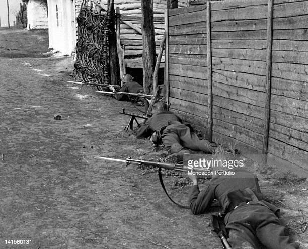 Hungarian soldiers in wait in a village in the Cherkasy area during a mopping up operation against bands of partisans Ukraine September 1941