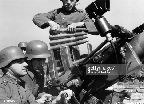 Hungarian soldiers loading an antiaircraft piece in the area of the Don River Russia September 1942
