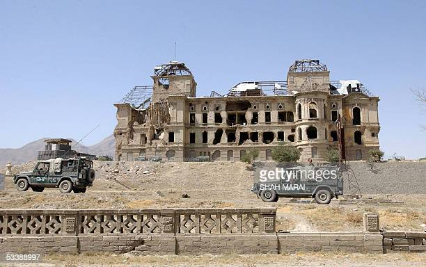 Hungarian soldiers of the International Security Assistance Force patrol near the war damaged Darlaman palace in Kabul, 15 August 2005. Security has...