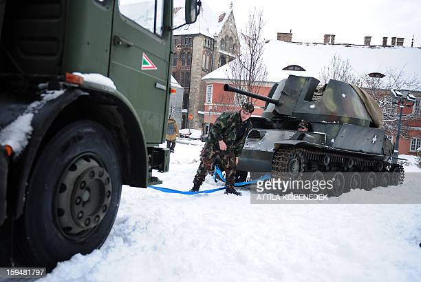 Hungarian soldiers prepare to transport a Hungarian made Nimrod armored car of the 2nd world war into the Military museum of Budapest 1st district on...