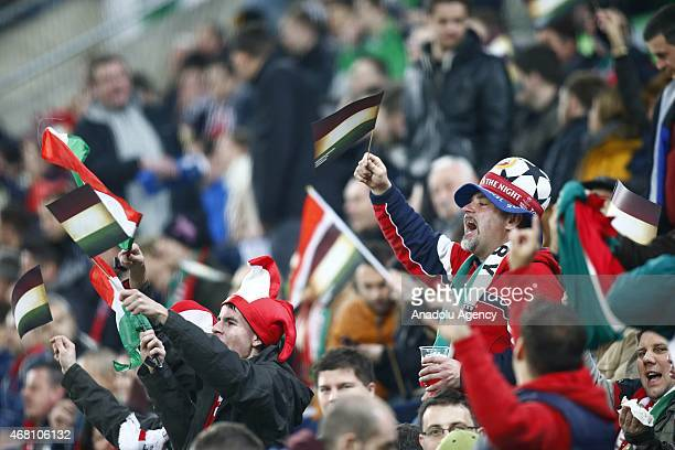 Hungarian supporters cheer their team during Hungary v Greece European Euro 2016 qualification soccer match at Grupama Arena in Budapest March 29 2015