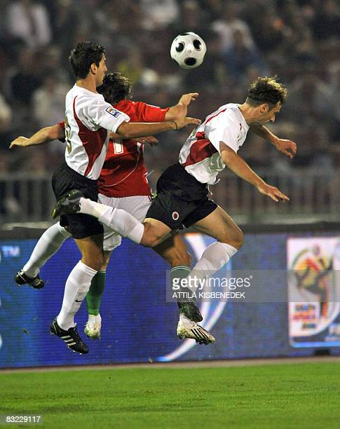 Hungarian Szabolcs Huszti is sandwiched by by Albanian Cama Lorik and nsi Agolli in Puskas Stadium of Budapest on October 11 2008 during a World Cup...