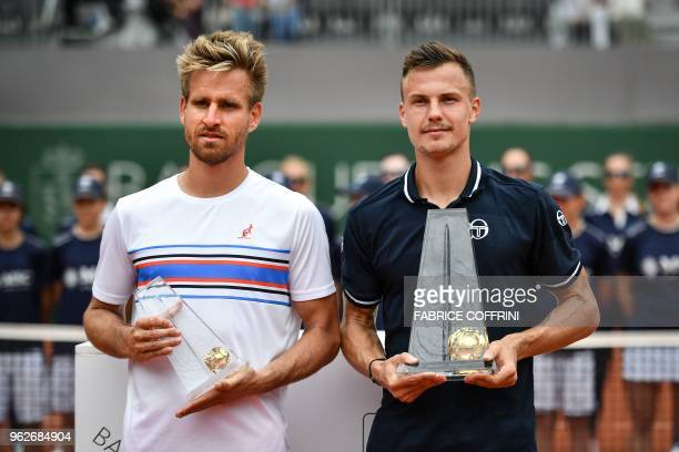 Hungarian tennis player Marton Fucsovics poses with German tennis player Peter Gojowczyk after winning the final game at the Geneva Open ATP 250...