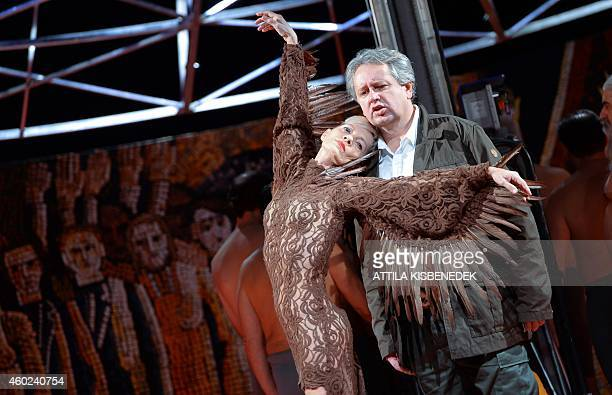 Hungarian tenor Istvan Kovacshazi sings with dancer Andre Ladanyi on the stage in Erkel Theater of Budapest on December 10 2014 during an opera...