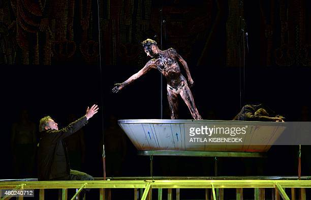 Hungarian tenor Istvan Kovacshazi sings with Hungarian dancer Andre Ladanyi in Erkel Theater of Budapest on December 10 2014 during an opera...