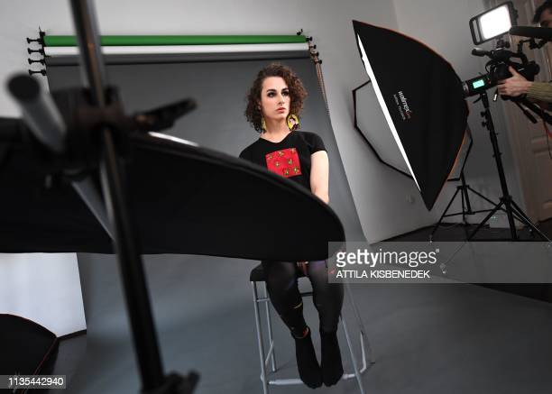 Hungarian transgender actress and model Adel Onodi poses with a creation by Hungarian Roma fashion designers of Romani Design during a shooting for a...