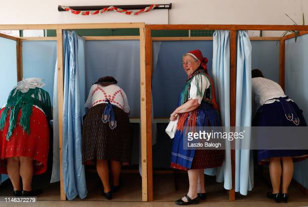 Hungarian women in traditional dress vote in the European parliamentary elections on May 26 2019 in Veresegyhaz Hungary Hungary will vote today to...
