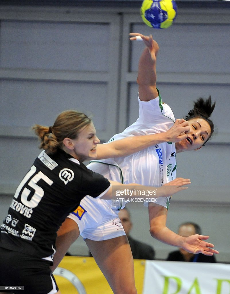 Hungarian Zita Szucsanszky (R) of FTC Rail Cargo Hungaria is fouled by Slovenian Barbara Varlec-Lazovic (L) of RK Krim Mercator in the local sports hall of Dabas on February 17, 2013 during their EHF Women's Champions League handball match.