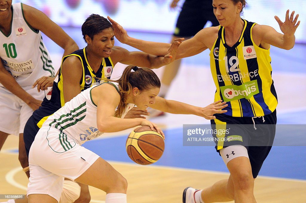 Hungarian Zsofia Somon (C) of Hungarian Hat-Agro UNI Gyor leads the ball against Latvian Ieva Kublina (R) and U.S. Angel McCoughtry (L) of the Turkish Fenerbahce Istanbul in Gyor on February 22, 2013 during their EuroLeague match.