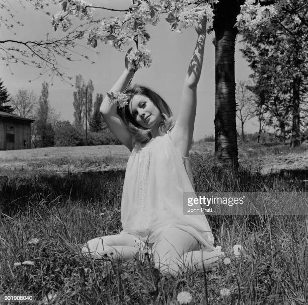 Hungarianborn actress Catherine Schell poses in the garden of a chateau in Prague Czechoslovakia during the filming of 'Hell Is Empty' April 1966