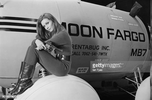 Hungarianborn actress Catherine Schell rides the 'Moon Fargo' lunar stagecoach on the set of the science fiction film 'Moon Zero Two' during...