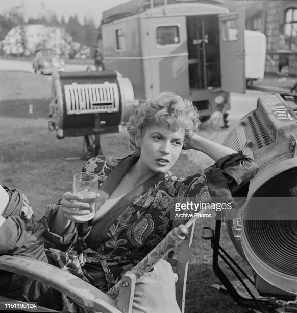 Hungarianborn actress Eva Bartok relaxing on the set of a film circa 1955