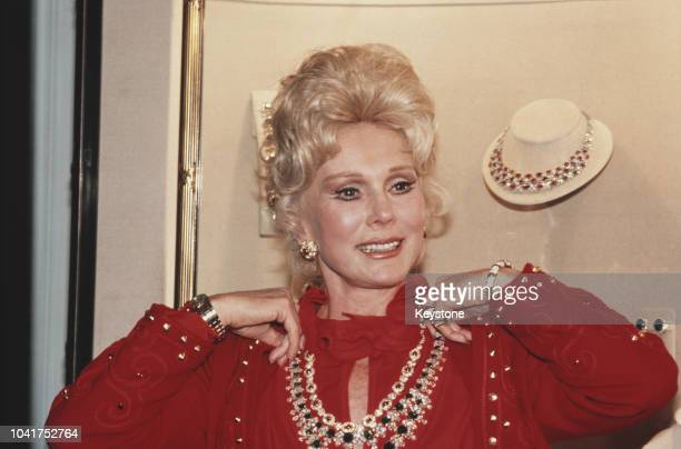 Hungarian-born actress Eva Gabor modelling jewellery by Harry Winston on the eve of the 'Night of 100 Stars', circa 1982.