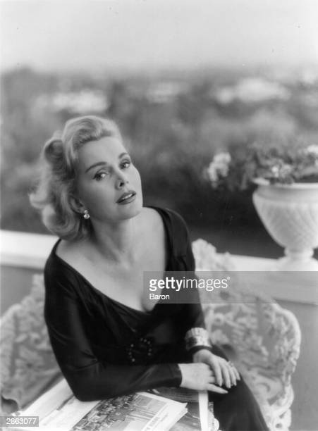 Hungarianborn actress Zsa Zsa Gabor sitting on a balcony Original Publication People Disc HE0218