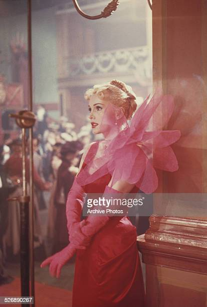 Hungarian-born American actress Zsa Zsa Gabor as she appears in the film 'Moulin Rouge', 1952. She is wearing a dress designed by Elsa Schiaparelli.
