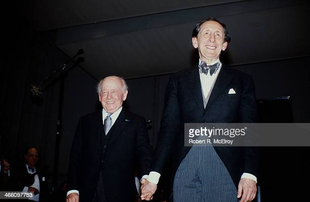 Hungarian-born American conductor Eugene Ormandy and Russian-born American pianist Vladimir Horowitz smile from the stage at Carnegie Hall, January...