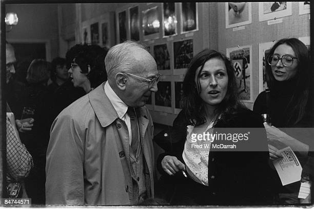 Hungarianborn American photographers Andre Kertesz and Sylvia Plachy talk at an exhibition of Village Voice photographs at the Overseas Press Club...