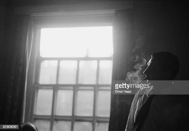 Hungarianborn American photojournalist Robert Capa during a visit to film director John Huston in hospital 1953