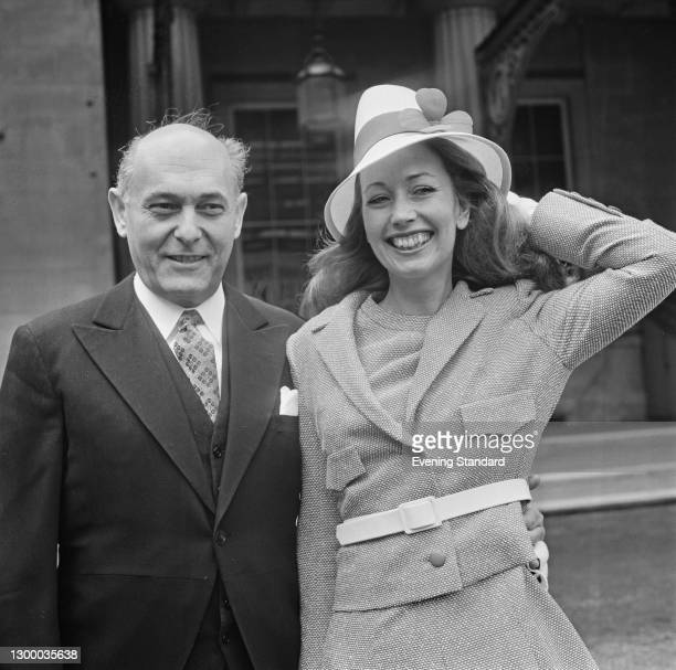 Hungarian-born British conductor Sir Georg Solti receives his knighthood at Buckingham Palace in London, UK, 28th March 1972. He is accompanied by...