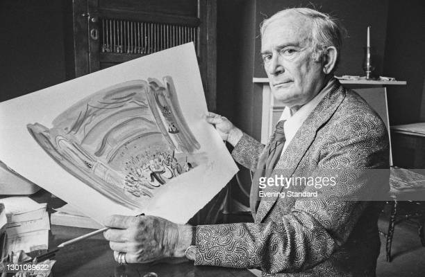 Hungarian-born painter and art forger Elmyr de Hory holds up a work in the style of Fauvist painter Raoul Dufy, UK, 18th July 1973. He appeared in...