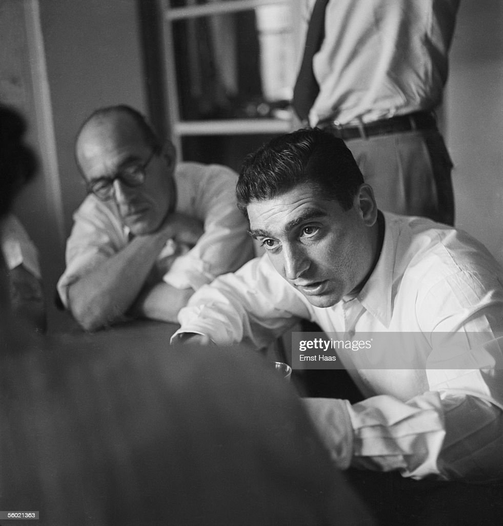 Hungarian-born photojournalist Robert Capa (1913 - 1954, right) chairs a meeting of the Magnum photographic co-operative, Paris, circa 1947.