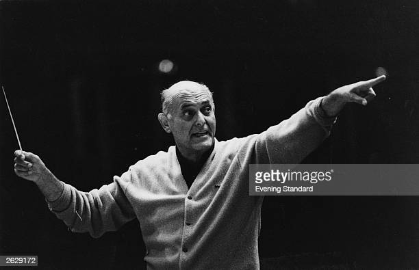 Hungarian-born Sir Georg Solti conducting the Chicago Symphony Orchestra at the Albert Hall. Solti toured extensively with the CSO after his...