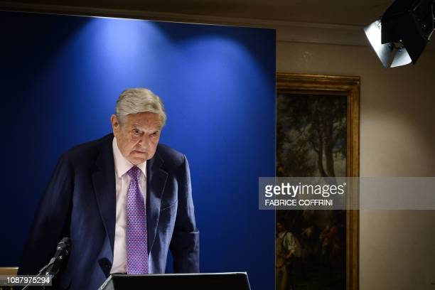 Hungarianborn US investor and philanthropist George Soros arrives to deliver a speech on the sideline of the World Economic Forum annual meeting on...