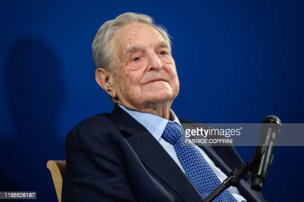 Hungarianborn US investor and philanthropist George Soros looks on after having delivered a speech on the sidelines of the World Economic Forum...