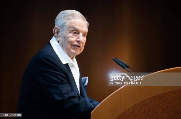 Hungarianborn US investor and philanthropist George Soros talks to the audience after receiving the Schumpeter Award 2019 in Vienna Austria on June...