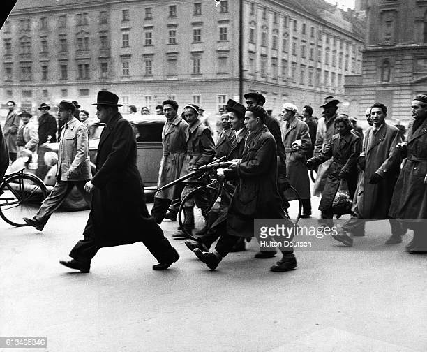 Hungarians arrest a member of the secret police during the revolution of 1956 The secret police were much hated because of their treatment of...