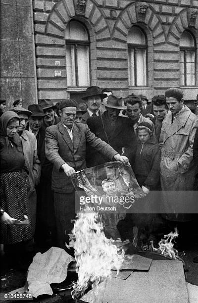 Hungarians burn a picture of the Communist Soviet leader Josef Stalin during the antiCommunist revolution in 1956