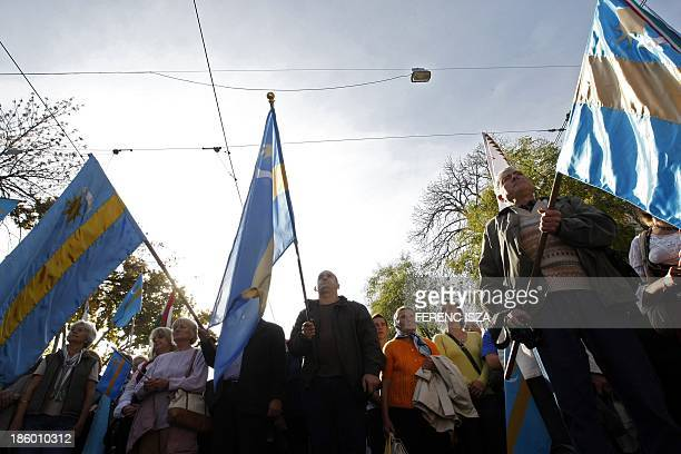 Hungarians hold Hungarian and Transylvanian flags as they take part in a demonstration for the autonomy of Transylvanian territory from Romania in...